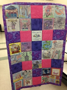 Amazing middle grade authors quilt presented to Mrs. Laird, the organizer, by the school.