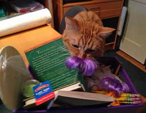 Fred inspects his gift basket.